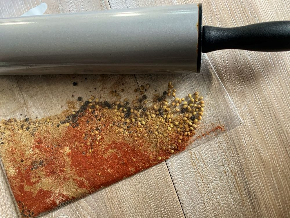 crushing spices with a rolling pin